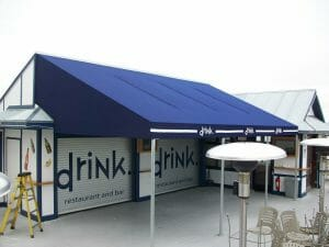 Canvas patio canopy with custom cut-outs and valance logos in Minneapolis
