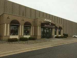 Dome awnings by Acme Awning create a classic look at Abdallah's store front