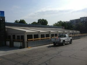 Motorized retractable canopy with motorized screen panels create a protected outdoor space