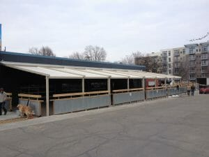 Commercial buildings make use of motorized retractable awnings from Acme Awning