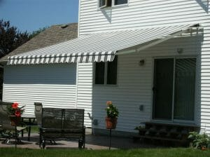 Patio cover with adjustable arms and motor by Acme Awning
