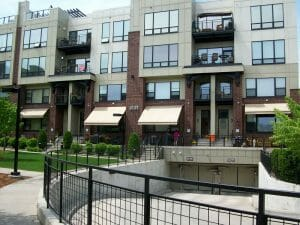 Retractable awnings create a sleek and modern look at this Twin Cities condo development