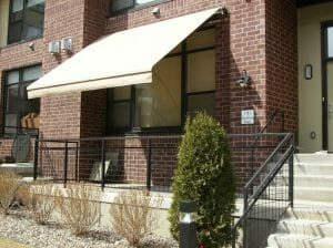 Roller awning over front patio in the Twin Cities