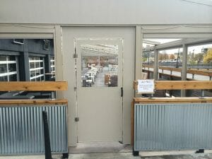 Acme Awning can keep the breeze out with a seasonal vestibule door