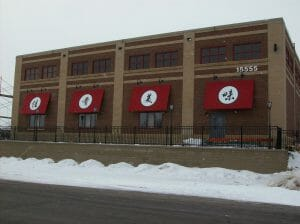 Acme Awning in Minneapolis builds custom awnings with graphics
