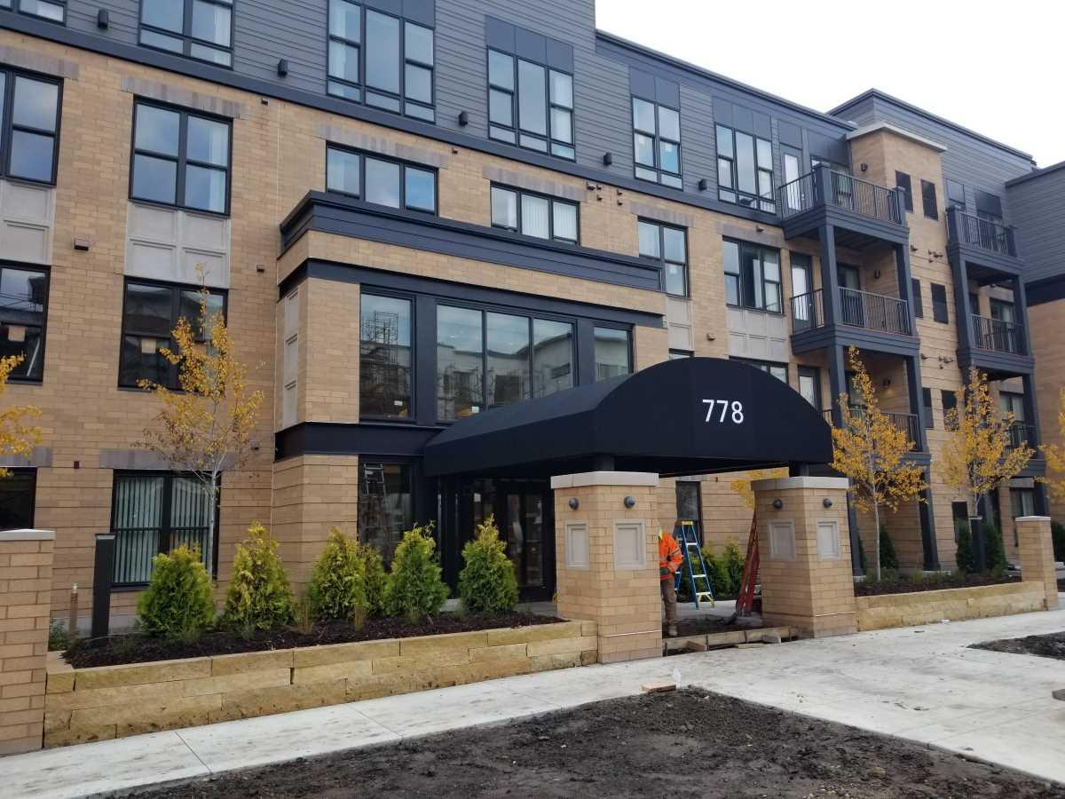 Half Barrel Canopy over Apartment Building Entrance