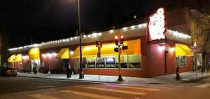 Street view of the full Conga Latin Bistro building at night